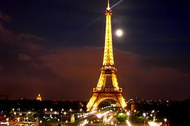 The Eiffel Tower! I'd love to eat in a restaurant that overlooks the Eiffel Tower at night! Oh bliss!
