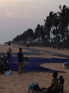 When we passed again in the evening, we saw it was indeed a fishing net and that everyone who was in the line shared in the catch at the end of the day.