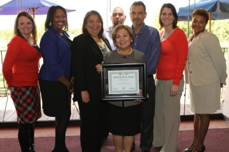 Josie and her team with the Small Business Award granted by the Governor of Texas