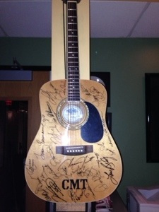 Autographs on the guitar at Sound Kitchen