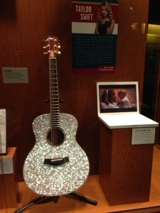 Taylor's blinged out guitar and her baby picture