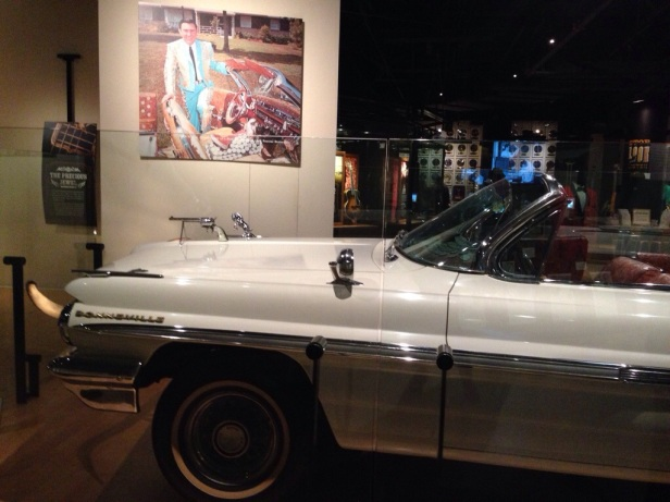 Webb Pierce poses with his almost-as-famous customised car!