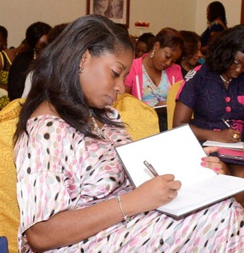 Taking notes at a recent event by the Inspired Women of Worth Network, where it's all about being the very best you!